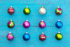 Arrangement of colorful Christmas balls on blue Royalty Free Stock Photos