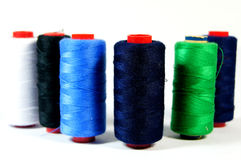 Arrangement of colorful spools of thread. On a white background Royalty Free Stock Photos