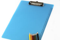 The arrangement of colourful pencils and clipboard. Back to school, back to work Stock Photos