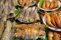 Fish Market Street Food. An arrangement of cooked crab, shrimp, prawn, mantis prawn shellfish crustacean seafood at a fish market food stall in Phuket, Thailand royalty free stock photos