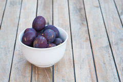 Arrangement of damson plums on wooden boards Royalty Free Stock Photos