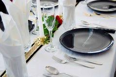 Arrangement de table de dîner de plat noir Photographie stock libre de droits