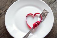 Arrangement de Tableau avec le coeur rouge Photo stock