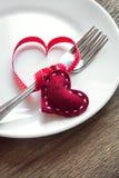 Arrangement de Tableau avec les coeurs rouges Image stock