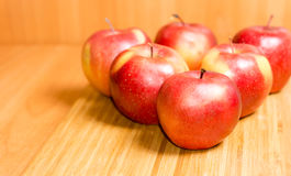 Fresh red apples on a wooden background Stock Photos