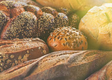 Arrangement of different breads at the bakery. Royalty Free Stock Images