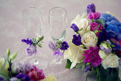 Arrangement of different flowers is on the table Royalty Free Stock Photo
