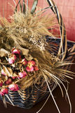 Arrangement of dried roses in a basket Royalty Free Stock Images