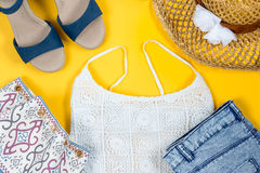 Arrangement of female summer clothes, beach style. Top view stock images