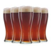 Arrangement of five beer glasses Stock Photo