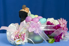 Arrangement with flowers and candy boxes Stock Images
