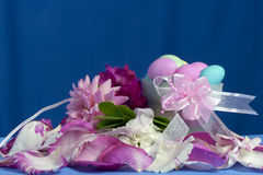 Arrangement with flowers and candy boxes Stock Image