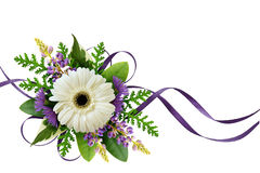 Arrangement with flowers and silk ribbons Stock Image