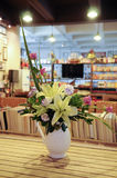 Arrangement Flowers in Vase. Indoor decorative vase with beautiful flowers in a book bar Stock Photography