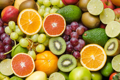 Arrangement fresh fruits and vegetables background Stock Photos