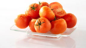 Arrangement of fresh tomatoes on a plate. Arrangement of fresh tomatoes on a glass plate royalty free stock photography