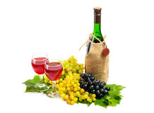 Arrangement of grapes. With a bottle of wine and glasses Royalty Free Stock Photo