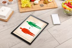 Arrangement of healthy Ingredients with a tablet. Stock Images