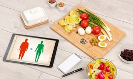 Arrangement of healthy Ingredients with a tablet. Stock Photo