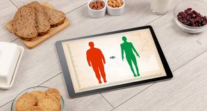 Arrangement of healthy Ingredients with a tablet. stock photos