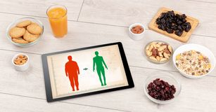 Arrangement of healthy Ingredients with a tablet. royalty free stock image