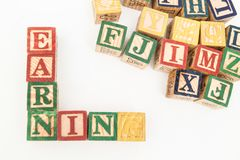 The arrangement of letters forms one word, version 103. The arrangement of letters forms one word, composing letters into one word, EARNING stock image