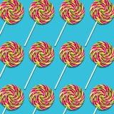 Arrangement of lollipop candies on turquoise background. Symmetrical arrangement of lollipop candies on turquoise background, colorful sweet food texture royalty free illustration