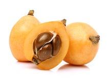 Arrangement of Loquat Medlar Fruit Full Body and One Half of isolated on White background Royalty Free Stock Photo