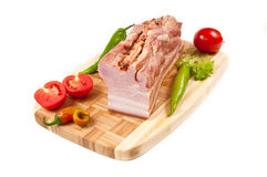Arrangement with meat smoked bacon and vegetables. Arrangement with meat smoked bacon, tomatoes and pepper on cutting board Stock Photo