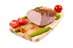 Arrangement with meat smoked bacon and vegetables. Arrangement with meat smoked bacon, tomatoes and pepper on cutting board Stock Images