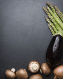Arrangement of mixed vegetables on dark stone copyspace. Royalty Free Stock Photo