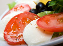 Arrangement of mozzarella and tomatoes. Stock Photo