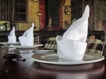 Arrangement of napkins on plates Stock Images