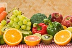 Arrangement nutrition fresh fruits and vegetables Stock Photos