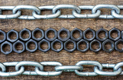 Arrangement of nuts bolts and iron chains Royalty Free Stock Image