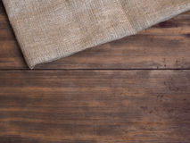 Arrangement of old wooden boards and burlap vintage background, photo top view Royalty Free Stock Image