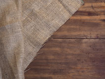 Arrangement of old wooden boards and burlap vintage background, photo top view Royalty Free Stock Images