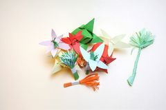 Arrangement of paper flowers. Which are scattered in disarray. This bouquet, flowerbed, created spontaneously. It can also be a symbol of unity alone, and the stock photography