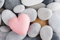 Arrangement of pebbles, pink soap. With word Love. SPA composition with bath bombs Stock Photos