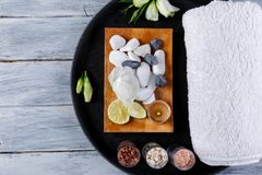 Arrangement of pebbles, towel and burning candles for aroma and spa treatments. Arrangement of various pebbles, white bath towel and burning candles for aroma Stock Photography