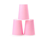 Arrangement of pink recycling paper glasses on white background. Row of recycling paper glass Royalty Free Stock Image