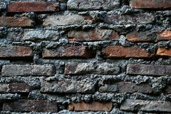 The arrangement of red bricks coated with white cement royalty free stock image