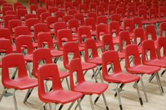 Arrangement of red chairs. Red chairs arranged in rows Royalty Free Stock Photos