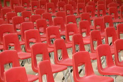 Arrangement of red chairs. Red chairs arranged in rows Royalty Free Stock Photo