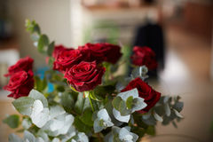 Arrangement Of Red Roses On Table Royalty Free Stock Photos