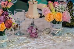 Arrangement for romantic dinners. With flowers and beads Stock Photos