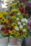 Arrangement of roses in a basket placed in market stall stock photo
