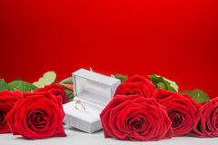 Arrangement of roses and golden ring Royalty Free Stock Photo