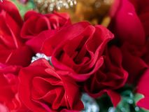 Arrangement of silk roses with tinsel royalty free stock image