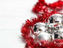 Arrangement with silver baubles and red garland Stock Photo